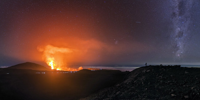 The photos were taken at the Piton de la Fournaise volcano on Reunion Island, a French island in the Indian Ocean one of the most active volcanoes in the world. Here: Luc Perrot taking pictures of the erupting volcano. (Photo by Luc Perrot/Caters News)