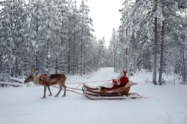 FINLAND: Santa Claus rides in his sleigh as he prepares for Christmas in the Arctic Circle near Rovaniemi, Finland December 15, 2016. (Photo by Pawel Kopczynski/Reuters)