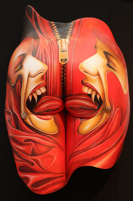 An painted cast of a woman's bottom is displayed at The Erotica 2009 exhibition at Olympia on November 20, 2009 in London. The three day event includes stalls selling s*x toys and a live stage show featuring erotic dancing.  (Photo by Peter Macdiarmid/Getty Images)