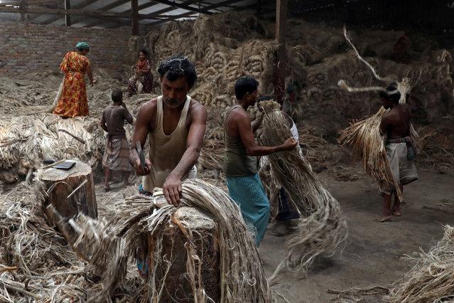 Employees work in a jute-processing mill in Narayanganj near Dhaka, Bangladesh, November 1, 2018. (Photo by Mohammad Ponir Hossain/Reuters)