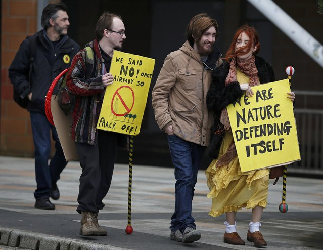 Anti-fracking demonstrators gather outside Blackpool Football Club on the opening day of the public enquiry into Lancashire County Council's decision to refuse permission for fracking at two sites, Blackpool in Britain February 9, 2016. Lancashire County Council in 2015 rejected fracking applications from energy firm Cuadrilla to extract shale gas from two sites on Lancashire's Fylde coast. (Photo by Phil Noble/Reuters)