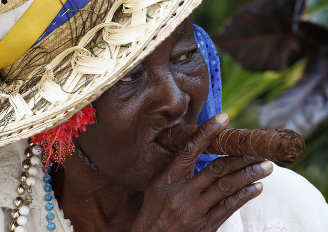 A street entertainer waits for tourists in Havana, October 2009. (Photo by Desmond Boylan/Reuters)