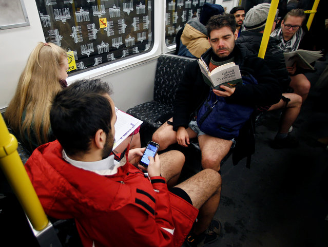 "People take part in the annual ""No Pants Subway Ride"" in Berlin, Germany, January 8, 2017. (Photo by Hannibal Hanschke/Reuters)"