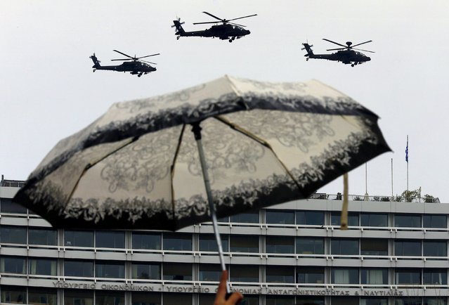 Greek Army helicopters fly over the Ministry of Finance during a military parade marking Independence Day celebrations in Athens March 25, 2015. (Photo by Yannis Behrakis/Reuters)