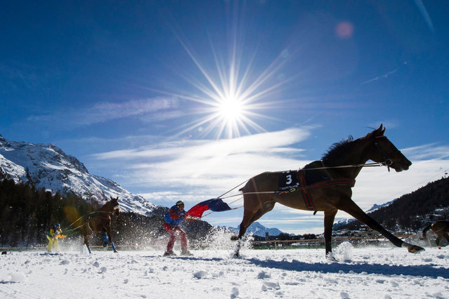 Adrian von Gunten with Mombasa, right, is on his way to win the Grand Prix Credit Suisse, a Skijoering race over 2,700 meters on the third weekend of the White Turf races in St. Moritz, Switzerland, 21 February 2016. (Photo by Gian Ehrenzeller/EPA)