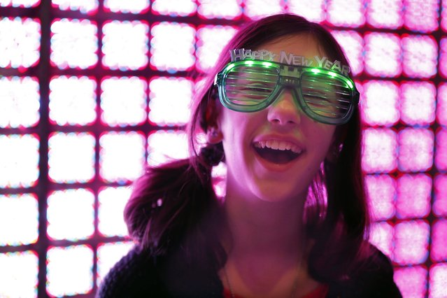 Katie Gabbia, 11, laughs in front of a light sculpture setup that is part of the New Year's Eve celebrations in Boston, Tuesday, December 31, 2013. (Photo by Michael Dwyer/AP Photo)