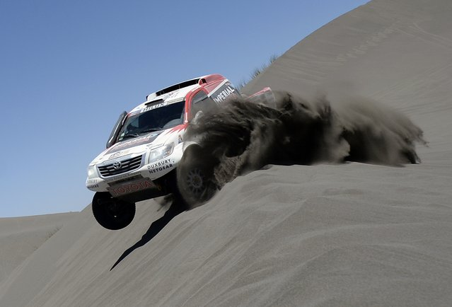 Toyota's driver Giniel De Villiers of South Africa and co-driver Dirk Von Zitzewitz of Germany, compete during the Stage 2 of the Dakar 2014 between San Luis and San Rafael, Argentina, on January 6, 2014. (Photo by Franck Fife/AFP Photo)