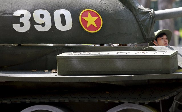A man drives a mock military Tank 390, which was operated by North Vietnamese forces and  first crashed through the gate of the former presidential palace, during a rehearsal for a military parade as part of the 40th anniversary of the fall of Saigon, in southern Ho Chi Minh City (formerly Saigon City), Vietnam, April 26, 2015. (Photo by Reuters/Kham)