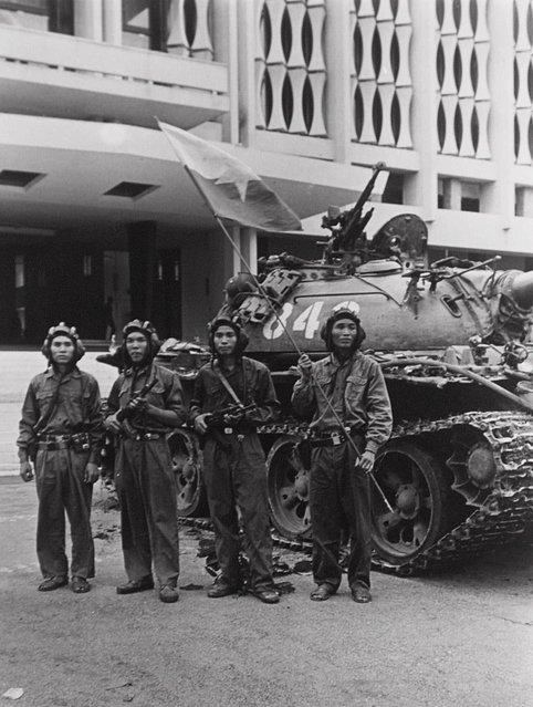 North Vietnamese pose in front of a tank outside the Presidential Palace in Saigon, South Vietnam on April 30, 1975, the moment that marked the end of the Vietnam war. This photo taken by North Vietnamese photograper Dinh Quang Thanh was among a series of images from the final day of the war that have not been widely seen outside his homeland. (Photo by Dinh Quang Thanh/AP Photo/Vietnam News Agency)