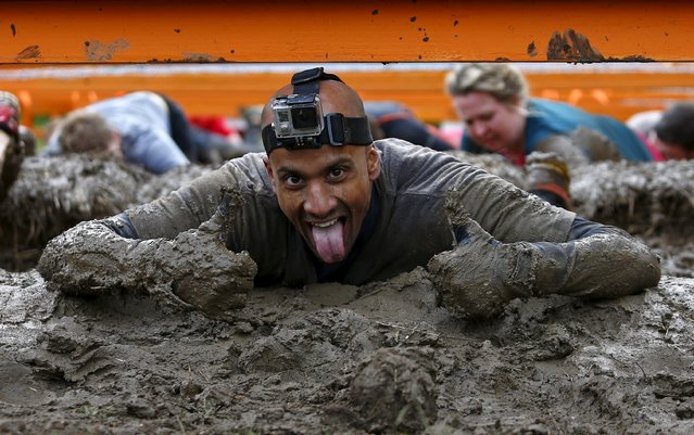 A competitor participates in the Tough Mudder challenge near Henley-on-Thames in southern England May 2, 2015. (Photo by Eddie Keogh/Reuters)