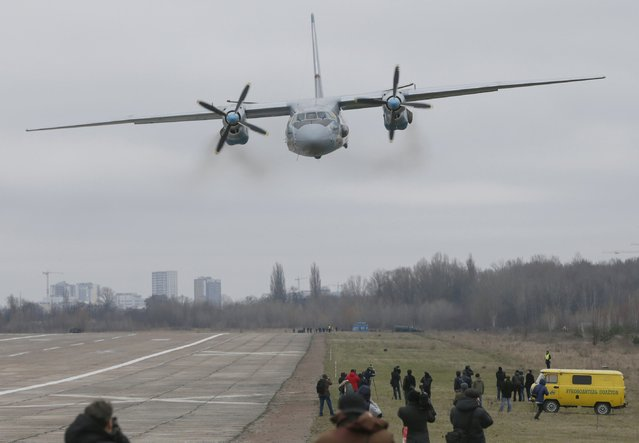 A Ukrainian Army Antonov An-26 aircraft flies over journalists after a handing over ceremony to a Ukrainian military unit at the Antonov plant in Kiev, Ukraine, March 17, 2016. (Photo by Valentyn Ogirenko/Reuters)