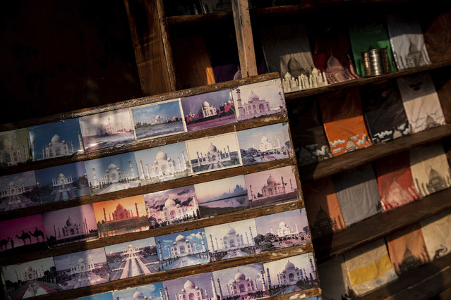 In this Wednesday, January 23, 2019 photo, Taj Mahal postcards are displayed in a souvenir shop in Agra, India. Despite being a UNESCO world heritage site, the mausoleum built by Muslim Mughal emperor Shah Jahan was not included as a listed attraction by the Uttar Pradesh tourism ministry in 2017. Chief minister Adityanath said foreign dignitaries should be gifted with the Bhagavad Gita, a Hindu religious text, instead of a replica of the monument. (Photo by Bernat Armangue/AP Photo)
