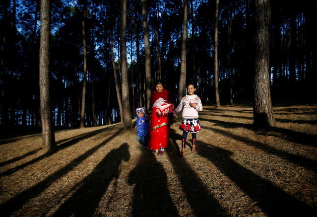 Devotees walk through the woods of Changu Narayan as they arrive to perform rituals and prayers during the Swasthani Bratakatha festival in Bhaktapur, Nepal February 8, 2017. (Photo by Navesh Chitrakar/Reuters)