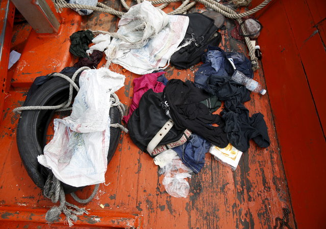 Clothes left behind on a boat that carried Rohingya migrants for three months is seen at Langkawi island, in Malaysia's northern state of Kedah May 12, 2015. (Photo by Olivia Harris/Reuters)