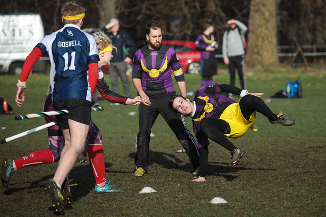 The snitch runner (R) dodges a tackle during a London Unspeakables vs Radcliffe Chimeras game during the Crumpet Cup quidditch tournament on Clapham Common on February 18, 2017 in London, England. (Photo by Jack Taylor/Getty Images)