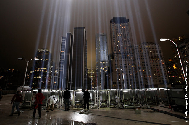 Workers adjust beams of the Tribute in Lights ahead of the tenth anniversary of the September 11 terrorist attacks