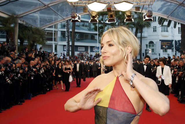 "Jury member actress Sienna Miller poses on the red carpet as she arrives for the screening of the film ""Maryland"" (Disorder) in competition for the category ""Un Certain Regard"" at the 68th Cannes Film Festival in Cannes, southern France, May 16, 2015. (Photo by Eric Gaillard/Reuters)"