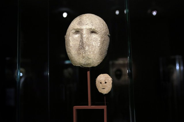 In this  Monday, March 10, 2014 photo, 9,000 year-old masks are on display at the Israel Museum in Jerusalem. (Photo by Tsafrir Abayov/AP Photo)