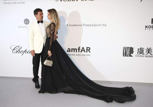 Actor Antonio Banderas and Nicole Kimpel pose for photographers upon arrival at the amfAR, Cinema Against AIDS, benefit at the Hotel du Cap-Eden-Roc, during the 72nd international Cannes film festival, in Cap d'Antibes, southern France, Thursday, May 23, 2019. (Photo by Joel C. Ryan/Invision/AP Photo)