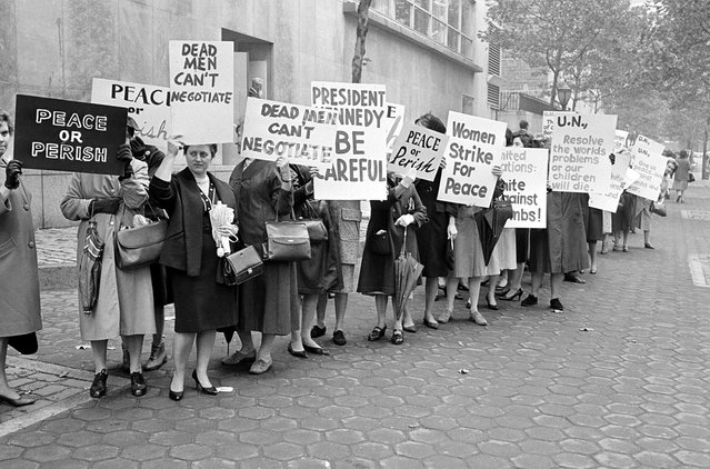 Picketers representing an organization known as Women Strike for Peace carry placards outside the United Nations headquarters in New York City, where the U.N. Security Council considers the Cuban missile crisis in a special meeting, on October 23, 1962. (Photo by AP Photo)