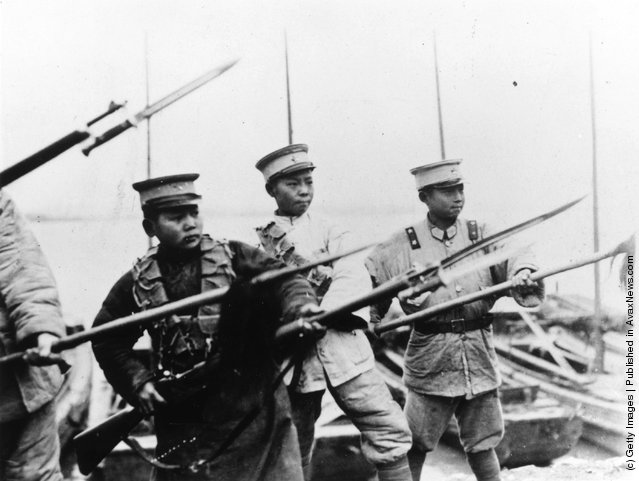 1922: Chinese boy soldiers in Marshal Sun's army helping in his fight against the 'red menace' from Canton