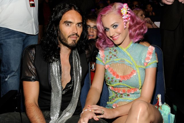Justin Bieber pops up behind Russell Brand and Katy Perry at the 2011 MTV Video Music Awards. (Photo by Frank Micelotta/PictureGroup/EMPICS Entertainment)