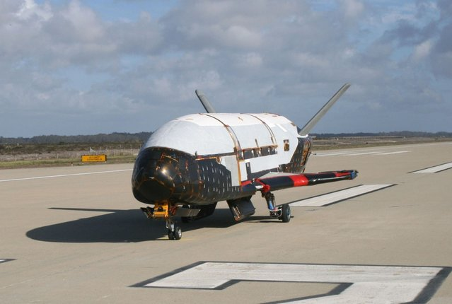This June 2009 photo made available by the U.S. Air Force via NASA shows the X-37B Orbital Test Vehicle at Vandenberg Air Force Base, Calif. On Wednesday, May 20, 2015, the Air Force launched its unmanned mini-shuttle from Cape Canaveral, Fla. Like the old shuttle, the X-37B launches vertically and lands horizontally, is reusable, and has lots of room for experiments. But no one flies on them; they are operated robotically. (Photo by U.S. Air Force via AP Photo)