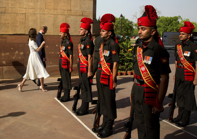 Britain's Prince William, along with his wife Kate, the Duchess of Cambridge leave after paying  their tributes at the India Gate war memorial, in the memory of the soldiers from Indian regiments who served in World War I, in New Delhi, India, Monday, April 11, 2016. (Photo by Manish Swarup/Pool Photo via AP Photo)