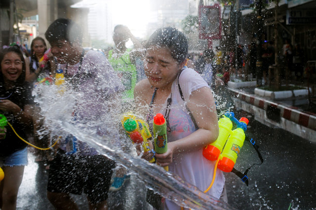A reveller reacts during a water fight at Songkran Festival celebrations in Bangkok April 13, 2016. (Photo by Jorge Silva/Reuters)