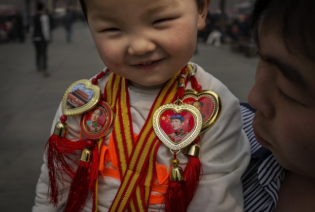 A young Chinese boy wears trinkets showing the image of the late Chairman Mao Zedong, the founder of the People's Republic of China on March 26, 2014 in Beijing, China. As the capital of the People's Republic of China, Beijing is one of the most populous cities in the world at over 21 million people. (Photo by Kevin Frayer/Getty Images)