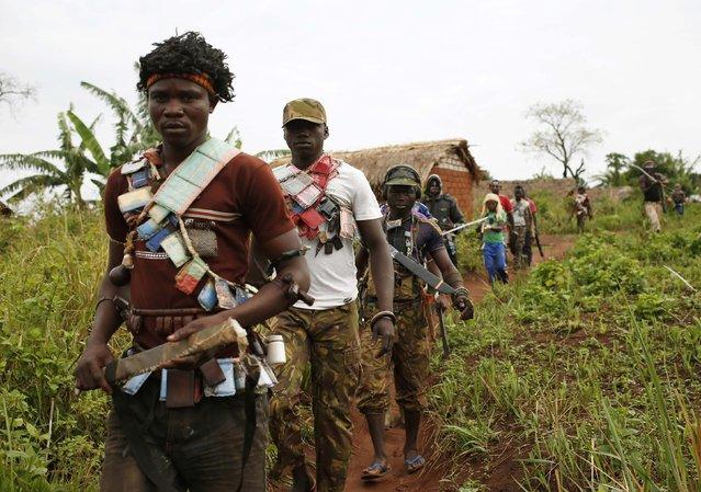 Members of the anti-balaka, a Christian militia, patrol outside the village of Zawa April 8, 2014. (Photo by Goran Tomasevic/Reuters)