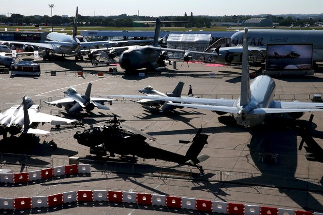 Airplanes are seen on display in the evening at the 51st Paris Air Show at Le Bourget airport near Paris, June 16, 2015. Picture taken June 16, 2015. REUTERS/Pascal Rossignol