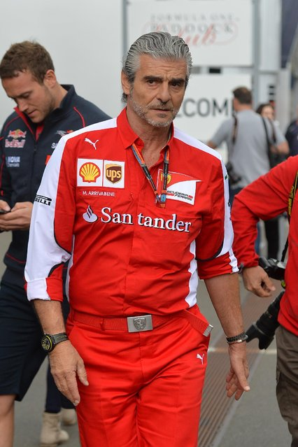 Ferrari team chief Maurizio Arrivabene walks in the paddock area prior to the Austrian Formula One Grand Prix race at the Red Bull Ring in Spielberg, southern Austria, Sunday, June 21, 2015. (AP Photo/Kerstin Joensson)