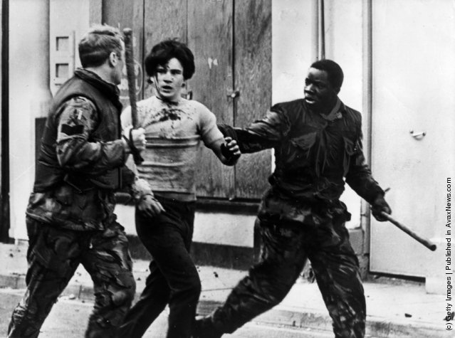 A teenage civilian is arrested by British troops during a civil rights demonstrations in Belfast, 1969