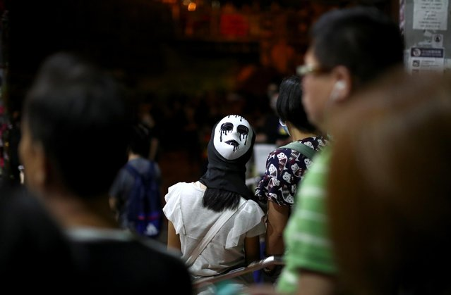 An anti-government protester wears a mask during a demonstration in Wong Tai Sin district, in Hong Kong, October 4, 2019. (Photo by Athit Perawongmetha/Reuters)