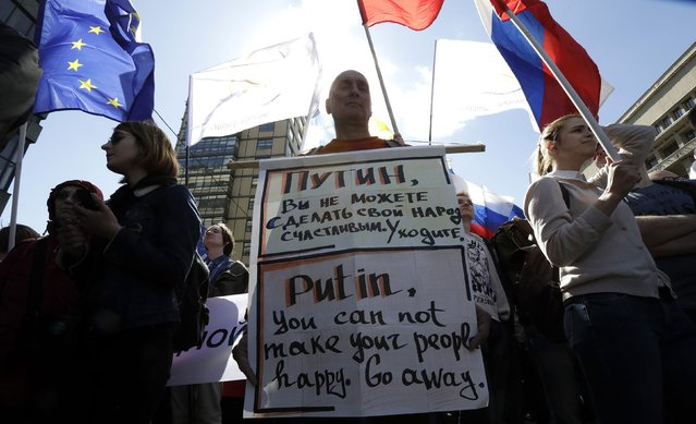 A Russian opposition supporter holds banner during a rally in Moscow, Russia, May 6, 2017. (Photo by Tatyana Makeyeva/Reuters)