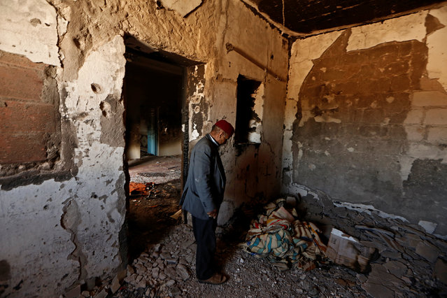Hamid Ishi stands in his house, which was squatted by Islamic State jihadists and damaged during fighting with government forces, in Ben Guerdane, Tunisia April 10, 2016. (Photo by Zohra Bensemra/Reuters)