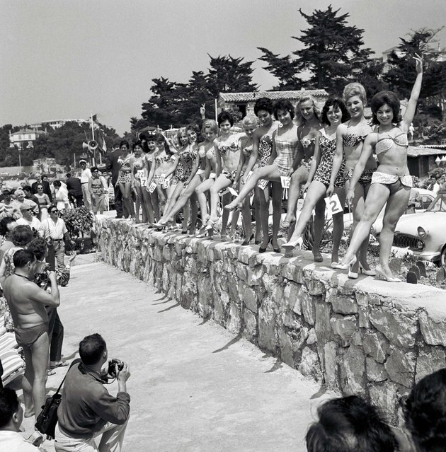 Women dressed in swimming costumes show off their bodies during a beauty contest. The 13th Cannes International Film Festival, France, 1960. (Photo by SIPA Press/Rex Features/Shutterstock)