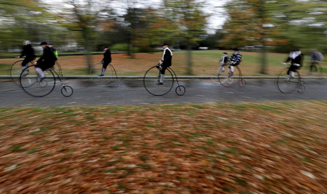 Participants wearing historical costumes ride their high-wheel bicycles during the annual penny farthing race in Prague, Czech Republic on November 2, 2019. (Photo by David W. Cerny/Reuters)