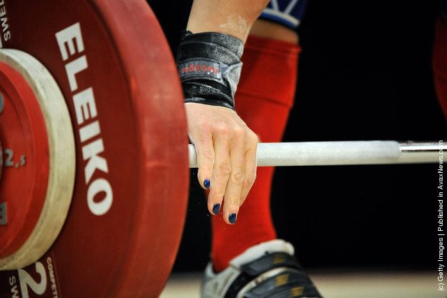 Jacquelynn Berube grasps the bar before attempting a 68 kilogram snatch during the 2012 U.S. Olympic Team Trials for Women's Weightlifting