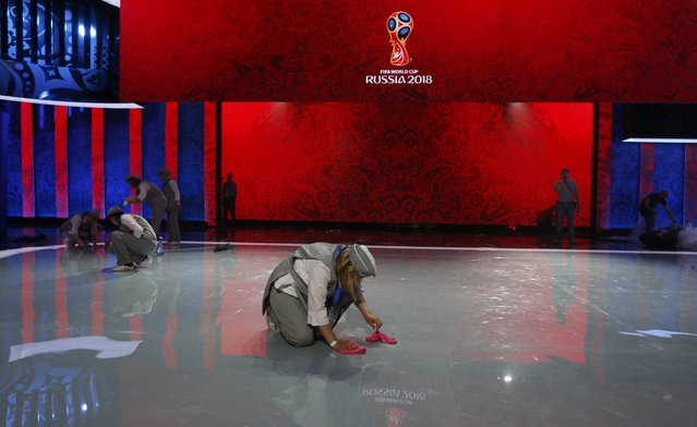 Cleaners prepare the stage before the preliminary draw for the 2018 FIFA World Cup at Konstantin Palace in St. Petersburg, Russia July 25, 2015. (Photo by Grigory Dukor/Reuters)