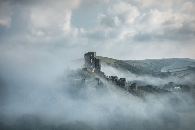 Shortlisted: Corfe Castle in the clouds, England by Michael Marsh. (Photo by Michael Marsh/Historic Photographer of the Year Awards 2019/The Guardian)