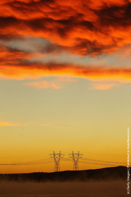 A view of power lines in early morning fog from the Hazelwood Power Station cooling pondage in Melbourne, Australia