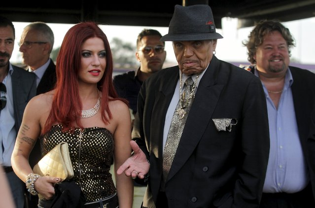 Joe Jackson (2nd R), patriarch of the Jackson family of musical performers and french singer Angelina Silitti visit the Brazilian soccer club Corinthians training center in Sao Paulo, Brazil, July 24, 2015. Jackson, patriarch of the Jackson family of musical performers, suffered a stroke in Brazil on Sunday and is being treated in a Sao Paulo hospital. (Photo by Antonio Araujo/Reuters)
