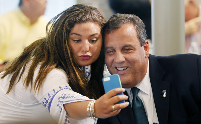 Kate Fallas takes a picture with Republican presidential candidate, New Jersey Gov. Chris Christie, before speaking to a group sponsored by Americans for Peace Prosperity and Security, Wednesday, July 29, 2015, in Manchester, N.H. (Photo by Jim Cole/AP Photo)