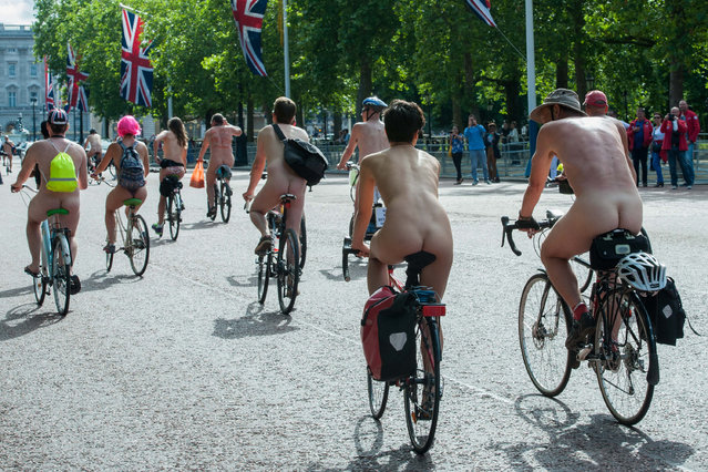 Naked cyclists ride through Central London as a protest against car culture and oil dependency during the Naked Bike Ride 2014. (Photo by Peter Maclaine/WENN.com)