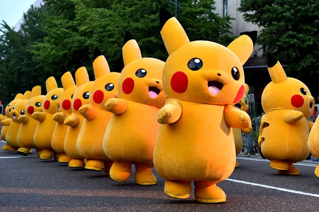 Costumed performers as Pikachu, the popular animation Pokemon series character, perform at the Yokohama Dance Parade in Yokohama on August 2, 2015. The dance began on August 1 and will run for 65 days throughout the city, with more than 200 dance programmes. (Photo by Kazuhiro Nogi/AFP Photo)