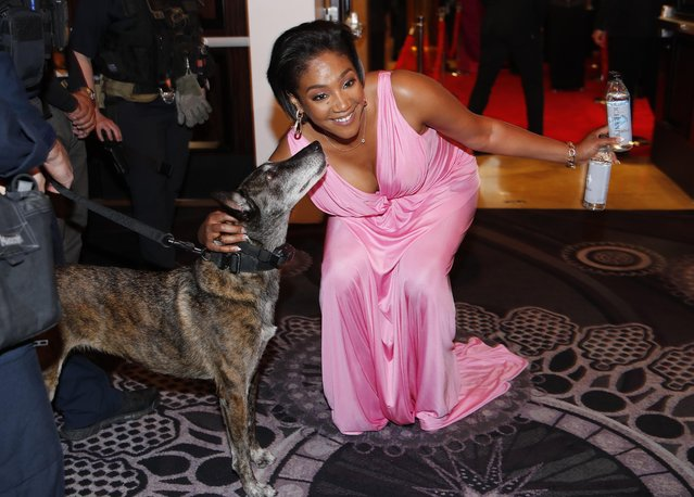 Tiffany Haddish pets a law enforcement dog at the 77th annual Golden Globe Awards at the Beverly Hilton Hotel on Sunday, January 5, 2020, in Beverly Hills, Calif. (Photo by Mike Blake/Reuters)