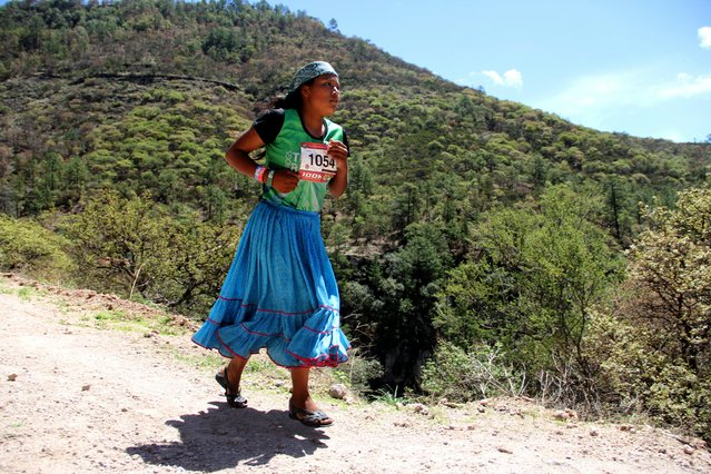 """A Raramuris indigenous woman takes part in the """"Ultra maraton de los Canones 2017"""" (Ultra marathon of the Canyons), at La Sinforosa Canyon, in Guachochi, Chihuahua state, Mexico on July 15, 2017. More than 600 participants from different countries take part in the 63 and 100 kilometers races, along the Tarahumara mountain range. (Photo by Herika Martinez/AFP Photo)"""