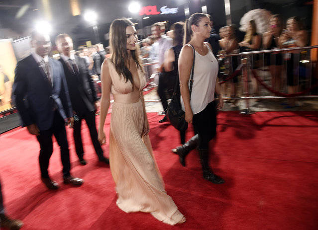 "Emily Ratajkowski, left, a cast member in ""We Are Your Friends"", walks the red carpet at the premiere of the film at the TCL Chinese Theatre on Thursday, August 20, 2015, in Los Angeles. (Photo by Chris Pizzello/Invision/AP Photo)"